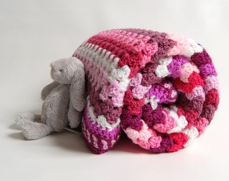 Rolled bunny pink stripe blanket